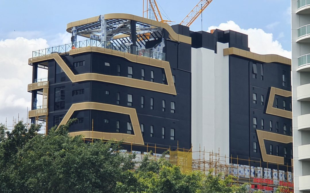 Black and Gold Aodeli SAP panels add an elegant touch to the iconic Monterey Apartments